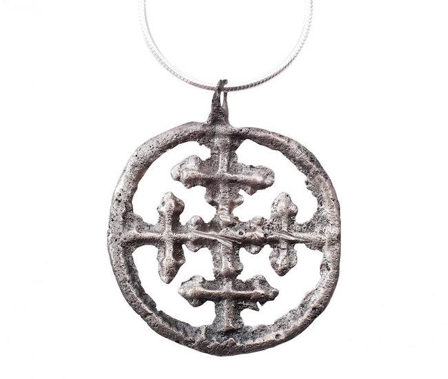 Crusader's cross pendant, Byzantine pilgrim's reliquary cross, silvered bronze, A.D. 1000-1200, 1 inch. Estimate: $200-$300